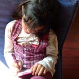 Naina busy doodling